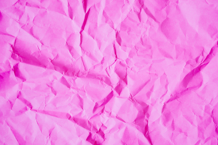 Crumpled pink paper texture background