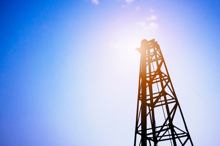 Silhouette pile driver at construction site Stock Photo