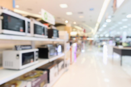 eletronic department store show microwave oven and home appliance with bokeh light abstract blur defocused background