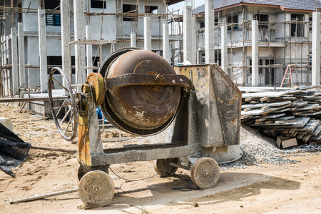 cement concrete mixer machine at new house building construction site