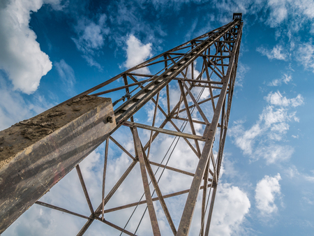 pile driver with clouds and blue sky Stock Photo