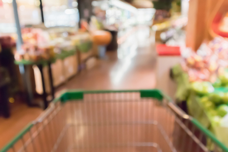 abstract blur organic fresh fruits and vegetable on grocery shelves in supermarket store defocused bokeh light background Stock Photo