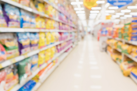 Abstract blur supermarket discount store aisle and pet food product shelves interior defocused background 写真素材