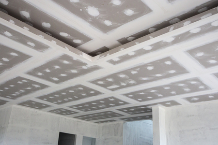 ceiling gypsum board installation at construction site