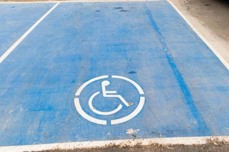 disable sign on blue paint color car park