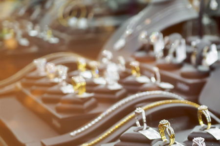 Abstract blur jewelry diamond shop with rings and necklaces luxury retail store showcase window display defocused background