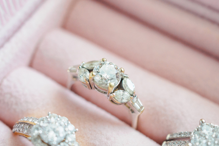 Gold and silver diamond ring in luxury jewelry box