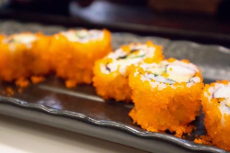 California maki sushi roll on black plate, japanese food 版權商用圖片