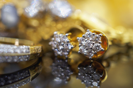 Luxury gold Jewelry diamond rings with reflection on black background Stock Photo