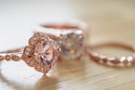 Jewelry pink sapphire rings on wood background Standard-Bild