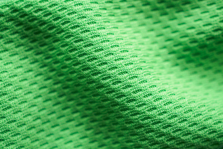 Green fabric sport clothing football jersey with air mesh texture background