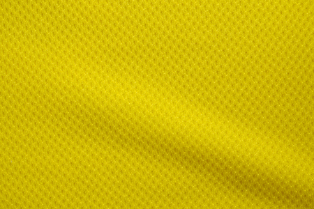 Yellow color football jersey clothing fabric texture sports wear background, close up