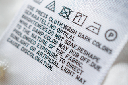 Cloth label tag with laundry care instructions 스톡 콘텐츠