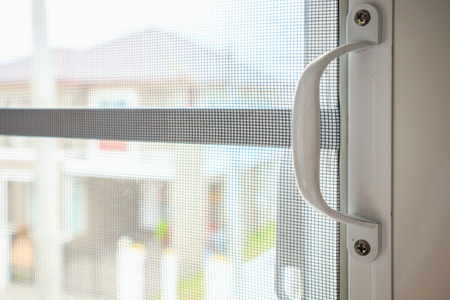 mosquito net wire screen on house window protection against insect Stock Photo