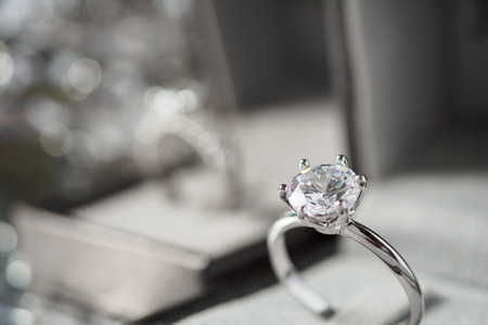 luxury engagement Diamond ring in jewelry gift box with bokeh light background Reklamní fotografie
