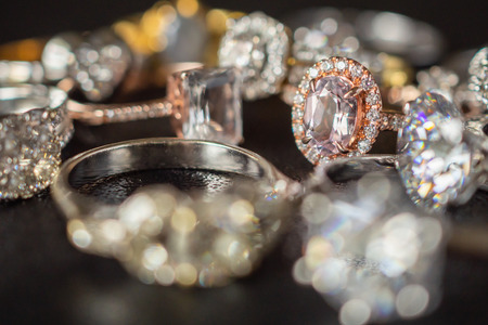 Jewelry rings on black background close up