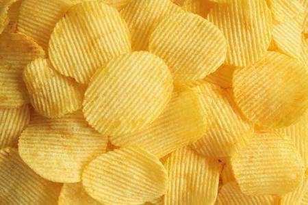 crispy potato chips snack texture background closeup top view