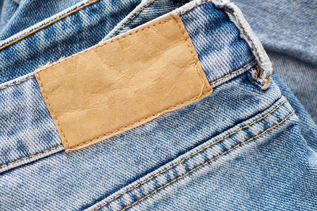 Blue denim jeans leather label texture background