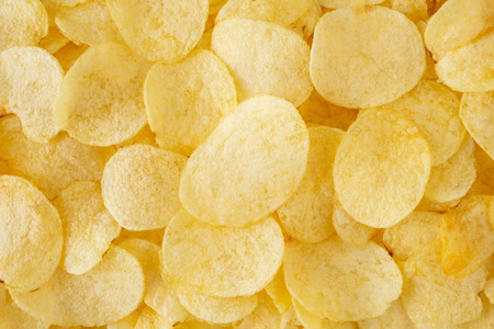 crispy potato chips snack texture background top view