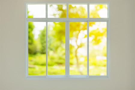 Modern house window with green garden view bokeh background