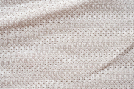 White fabric sport clothing football jersey with air mesh texture background