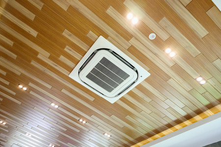 Ceiling air conditioner unit in modern room