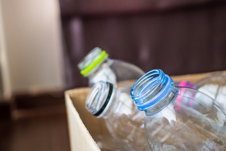 plastic bottles in recycling paper box reuse concept Zdjęcie Seryjne