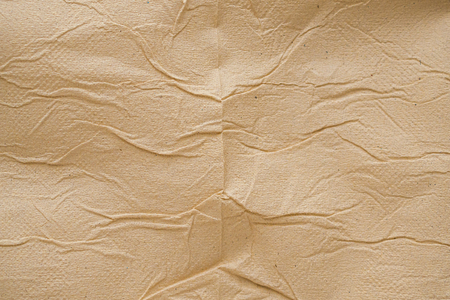 Crumpled brown recycle tissue paper texture abstract background