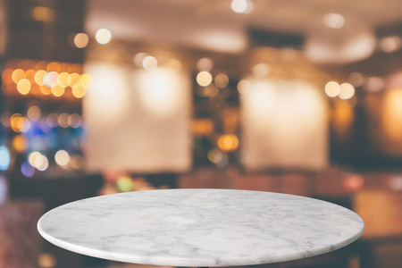 round marble table top with cafe restaurant bokeh lights abstract background for montage product display Zdjęcie Seryjne