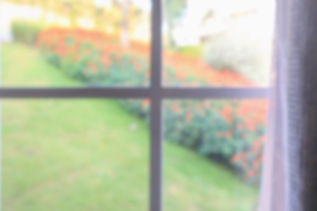 window curtain with green garden abstract blur background