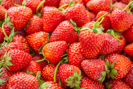 Fresh organic red ripe Strawberry fruit background closeup