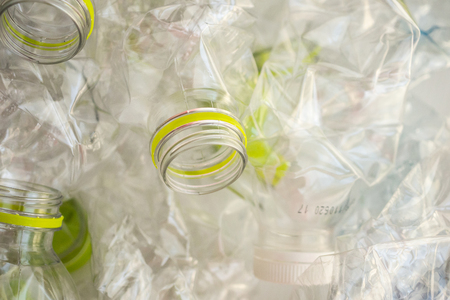 Crushed plastic bottles for recycling abstract background