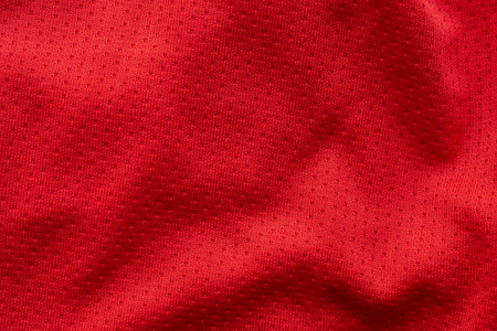 Red fabric sport clothing football jersey with air mesh texture background Zdjęcie Seryjne