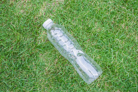 plastic bottle on green grass background recycle and pollution concept