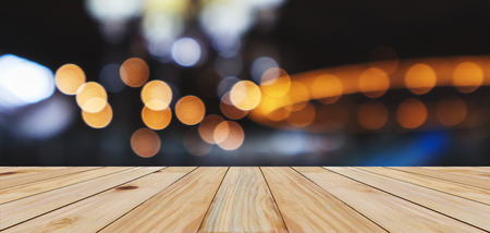 Empty wood table top with abstract blur bokeh light defocused background