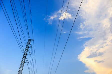 High voltage towers electric lines with clouds and sky Imagens