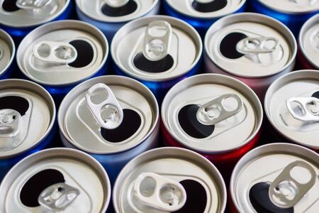 Empty aluminium drink cans recycling background concept