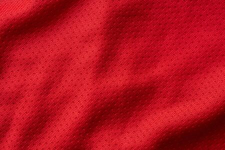 Red fabric sport clothing football jersey with air mesh texture background Stok Fotoğraf