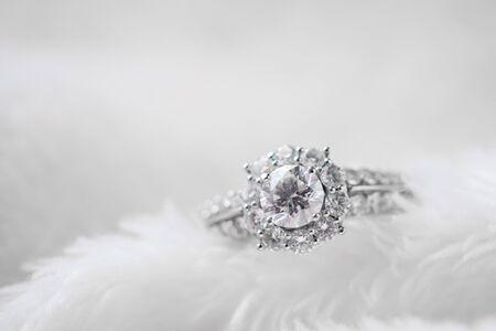 luxury jewelry diamond ring on white fur texture