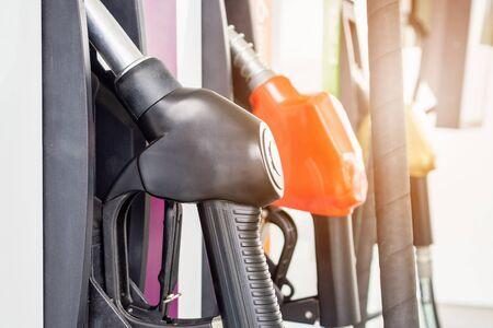 Petrol filling nozzles at gas station pump