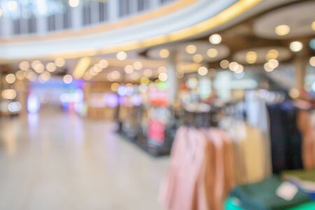 Abstract blur clothing boutique store display interior of shopping mall background