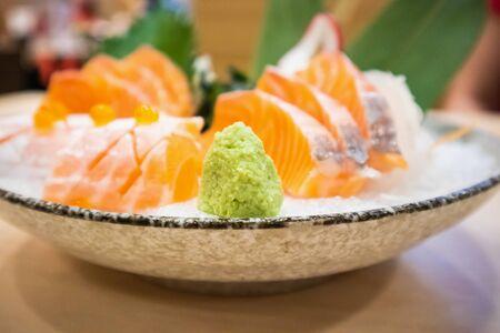 Wasabi with Fresh salmon slice sashimi serve on ice Japanese style Zdjęcie Seryjne