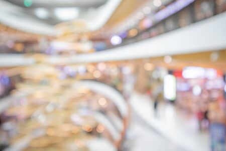 modern luxury shopping mall department store interior blur abstract defocused background with bokeh light