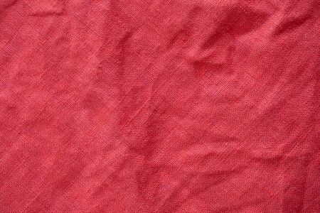 Red linen shirt fabric texture background