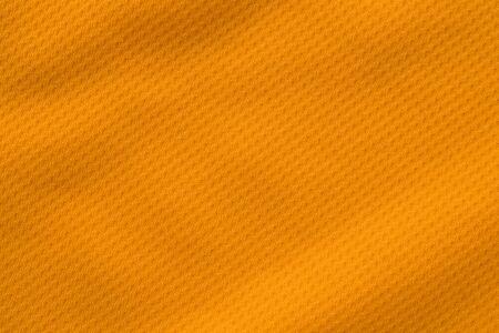 Orange color sports clothing fabric jersey football shirt texture top view Zdjęcie Seryjne