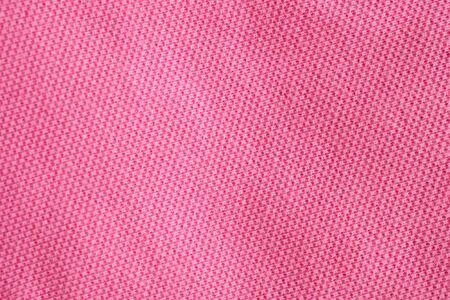 Pink cotton fabric texture closeup background