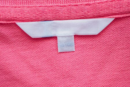 Blank white clothes label on new shirt