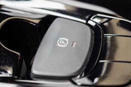 electronic handbrake button in luxury modern car Zdjęcie Seryjne