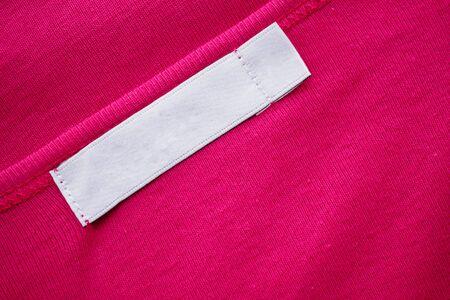 Blank white clothes tag label on new shirt Zdjęcie Seryjne