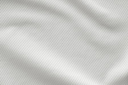White sports clothing fabric jersey football shirt texture top view close up Stockfoto - 128845247